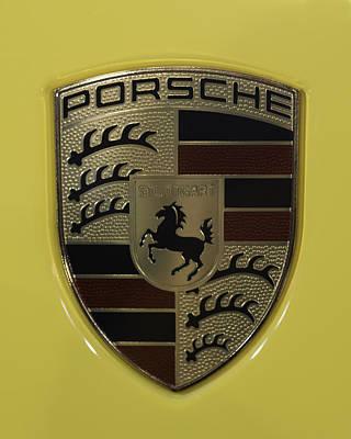 Porsche Emblem On Racing Yellow Print by Sebastian Musial