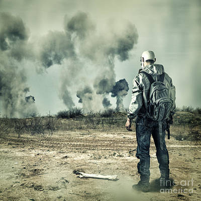 Post Apocalypse. Man In Gas Mask With Handgun And Back Pack In Apocalyptic World Looking On Explosio Print by Unknow