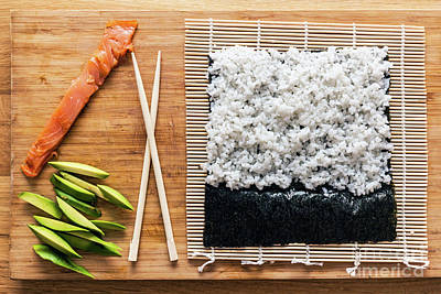 Dish Photograph - Preparing Sushi. Salmon, Avocado, Rice And Chopsticks On Wooden Table by Michal Bednarek