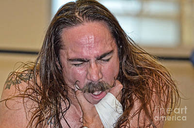 Long Hair Photograph - Pro Wrestler The Butcher Tyler Bateman Recovering From A Hit To The Jaw by Jim Fitzpatrick
