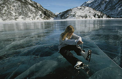 Natural Forces Photograph - Rebecca Quinton Laces Up Her Ice Skates by Michael S. Quinton