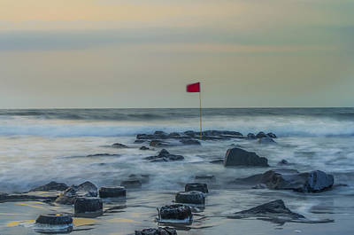 Photograph - Red Flag On A Jetty - Stone Harbor New Jersey by Bill Cannon