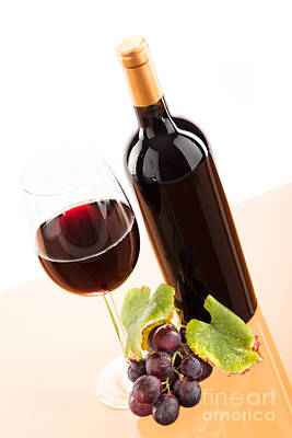 Red Wine In Glass With Bottle And Wine Grapes Print by Wolfgang Steiner