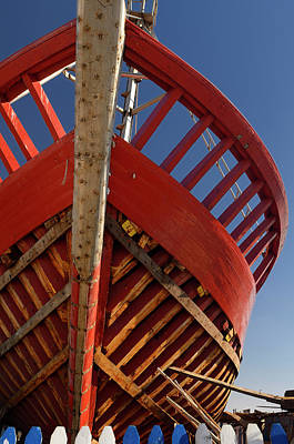 Morocco Photograph - Red Wooden Boat Under Construction At The Essaouira Port In Moro by Reimar Gaertner