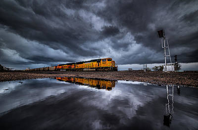 Dark Clouds Photograph - Riding The Storm Out by Darren  White