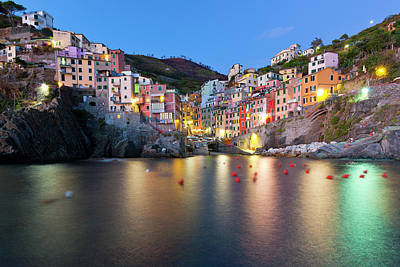 Illuminated Photograph - Riomaggiore After Sunset by Sebastian Wasek