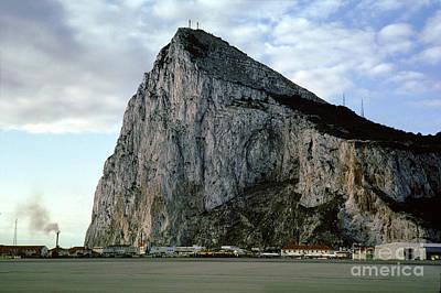 Rock Of Gibrlatar Stands Over The Gibraltar International Airpor Print by Wernher Krutein