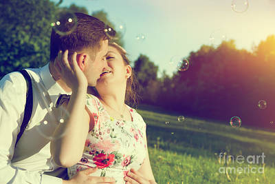 Dating Photograph - Romantic Couple Kissing With Love In Park by Michal Bednarek