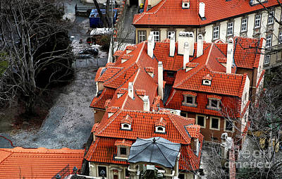Roofs In Prague Print by John Rizzuto