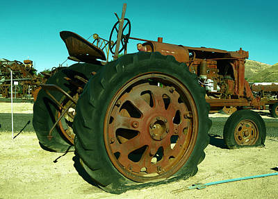 Rusty Old Tractor With A Flat Tire Print by Jeff Swan