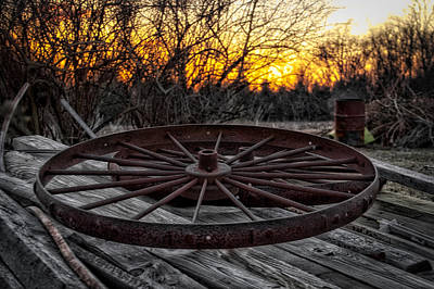 Rusty Wagon Wheel At Sunset Print by Thomas Woolworth