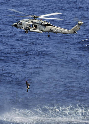 Photograph - Search And Rescue Swimmers by Stocktrek Images