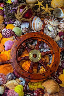 Wooden Ships Photograph - Ships Wheel Among Seashells by Garry Gay