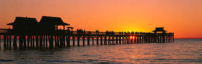 Collier Photograph - Silhouette Of Huts And A Pier At Dusk by Panoramic Images