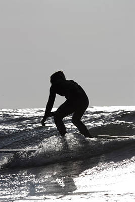 Surfers Photograph - Silhouette Of Surfer Riding Wave In Lake Michigan by Christopher Purcell