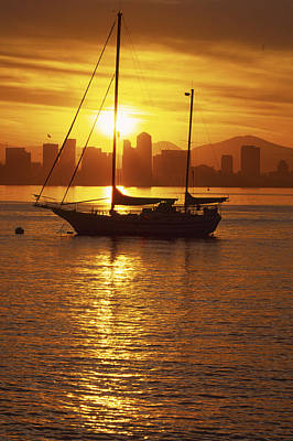 Natural Forces Photograph - Silhouetted Sailboat At Sunrise by Michael Melford