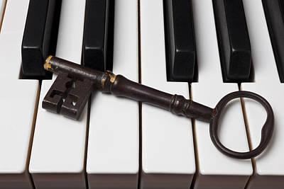 Skeleton Key On Piano Keys Print by Garry Gay