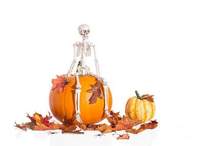 Skeleton Sitting On Pumpkin Print by Amanda Elwell
