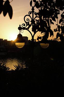 Streetlight Photograph - Sleeping Sun by Andrea Mazzocchetti