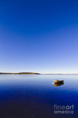Small Boat Anchored Out To Sea Print by Jorgo Photography - Wall Art Gallery