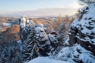 Snowy Rocks Of Saxon Switzerland Print by Jenny Rainbow