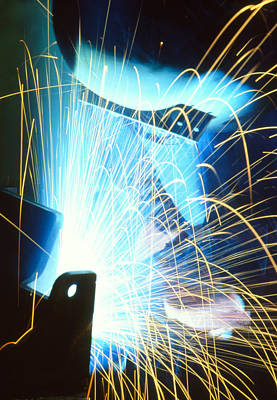 Sparks Flying From An Argon Welder At Work Print by Chris Knapton