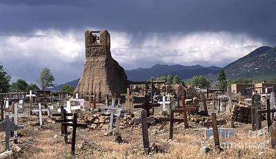 Pueblo Architecture Photograph - Storm Over Taos Graveyard by Sandra Bronstein