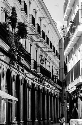 Black And White Photograph - Streets Of Seville - Calle Francos by Andrea Mazzocchetti