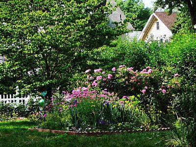 Suburban Garden With Roses Print by Susan Savad