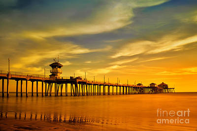 Sunset Over Huntington Beach Pier Print by Peter Dang
