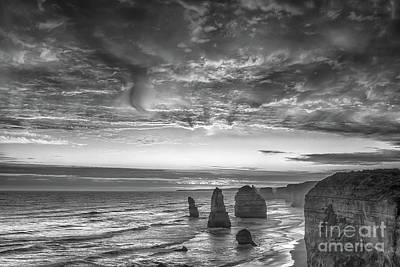 Blavk And White Photograph - Sunset Over The Apostles by Howard Ferrier