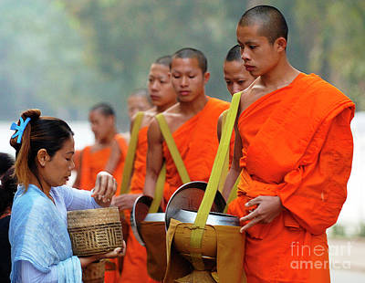 Buddhist Monks Photograph - The Art Of Giving by Bob Christopher