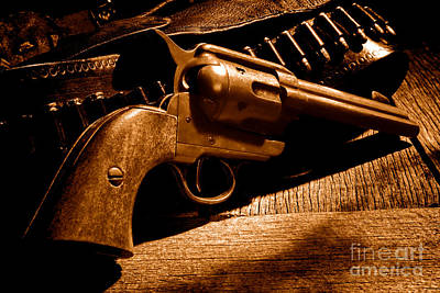 The Gun That Won The West - Sepia Print by Olivier Le Queinec