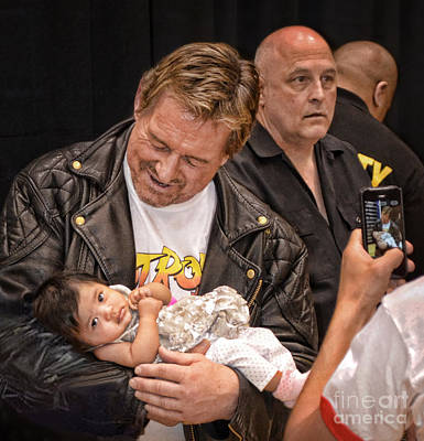 The Late Pro Wrestling Legend Roddy Piper Sharing A Special Moment With His Youngest Fan Print by Jim Fitzpatrick