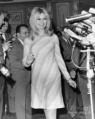 Bardot Photograph - The Lovely Brigitte Bardot Speaks At A News Conference. 1965 by Anthony Calvacca