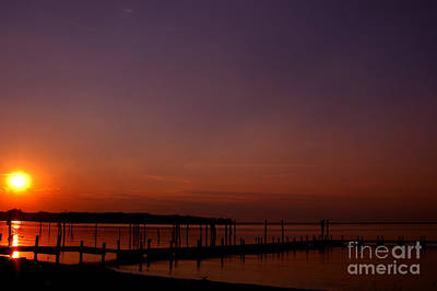 The Sun Sets Over The Water Print by Clayton Bruster