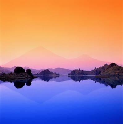 The Virunga Mountains Rise Above Lake Print by David Pluth
