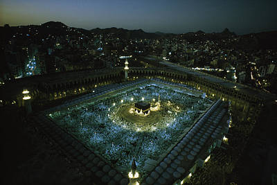 Mecca Photograph - Thousands Of Pilgrims Circle The Kaaba by Thomas J. Abercrombie