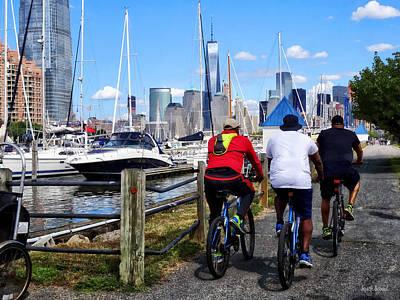 Boat Photograph - Three Bicyclists By Liberty Landing Marina by Susan Savad