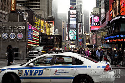 New York Cops Photograph - Times Square Police Car by John Rizzuto