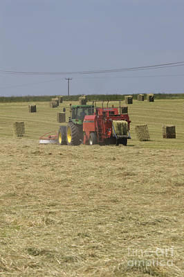 Tractor Bailing Hay In A Field At Harvest Time Pt Print by Andy Smy