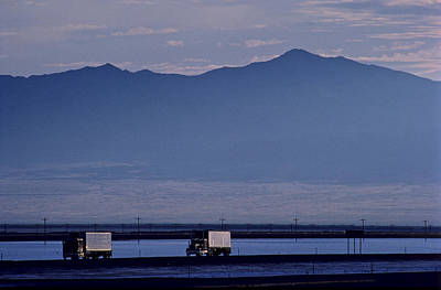 Transportation Of Goods Photograph - Trucks Along The Highway Next To Great by Kenneth Garrett