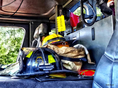 Truck Photograph - Two Firefighter's Helmets Inside Fire Truck by Susan Savad