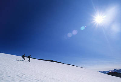Two Hikers Explore A Snowfield Print by Bill Hatcher