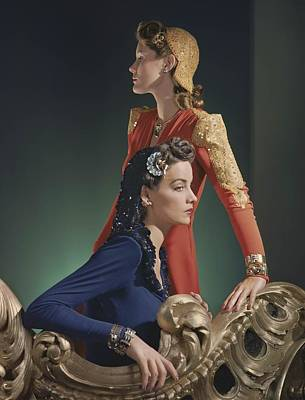 Ball Gown Photograph - Two Models, One Standing, In Red Silk by Conde Nast