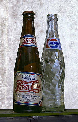 Two Pepsi Bottles On A Table Print by Daniel Hagerman