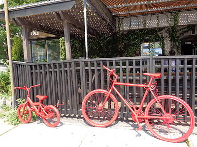 Two Red Bikes Print by J Andrel