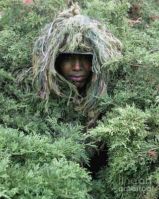 Camouflage Clothing Photograph - U.s. Army Soldier Demonstrates The Use by Stocktrek Images