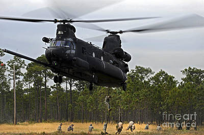 Helicopter Photograph - U.s. Army Special Forces Fast Rope by Stocktrek Images