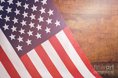 Usa Stars And Stripes Flag On Dark Wood Print by Milleflore Images